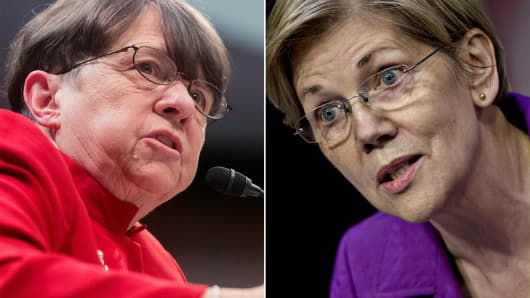 Mary Jo White, chairman of the U.S. Securities and Exchange Commission (SEC) and Senator Elizabeth Warren, a Democrat from Massachusetts
