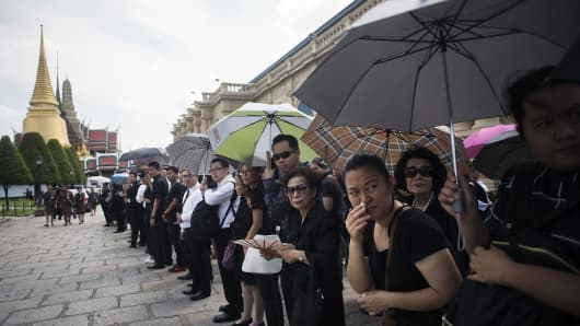 Thai people attend royal bathing ceremony at The Grand Palace in Bangkok on October 14.