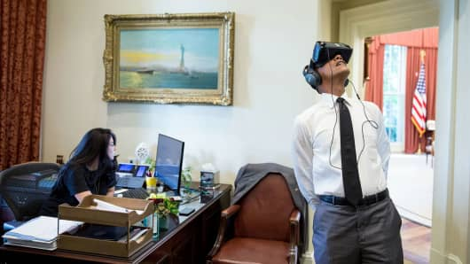 President Barack Obama watches a VR film of his trip to Yosemite National Park.