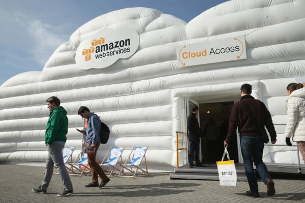 Visitors arrive at the cloud pavilion of Amazon Web Services at the 2016 CeBIT digital technology trade fair in Hanover, Germany last March.