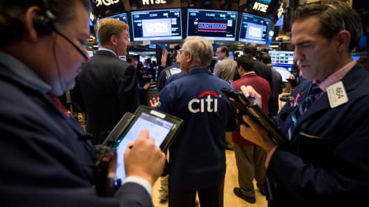 A trader, center, wears a Citigroup jacket while working on the floor of the New York Stock Exchange (NYSE) in New York.