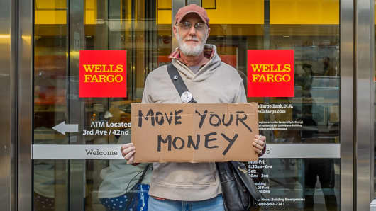 An activist protests outside a Wells Fargo branch in New York in this 2016 file photo.