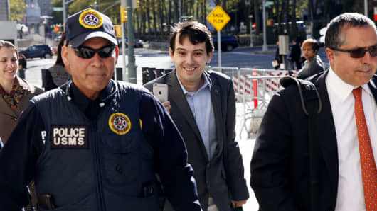 Martin Shkreli (C), former chief executive officer of Turing Pharmaceuticals and KaloBios Pharmaceuticals Inc, arrives for a hearing at U.S. Federal Court in Brooklyn, New York, October 14, 2016.