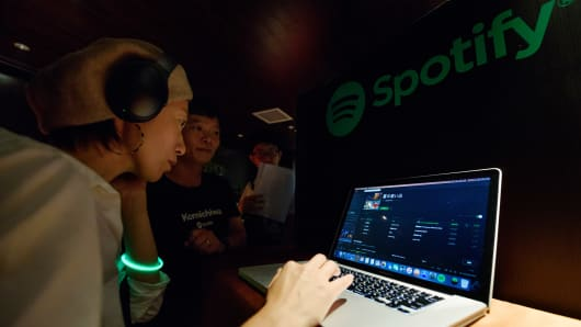 An attendee tries out Spotify Ltd.'s music streaming service, operated by Spotify Japan K.K., on a laptop computer during a launch event in Tokyo, Japan.