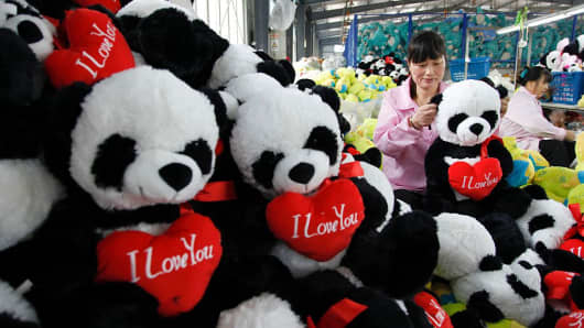 A Chinese worker making soft toys at a toy factory in Lianyungang, east China's Jiangsu province.
