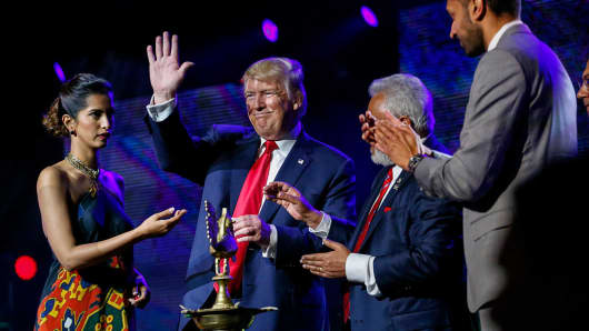 Republican presidential candidate Donald Trump (C) attends the Republican Hindu Coalition's Humanity United Against Terror Charity event on October 15, 2016 at the New Jersey Convention & Expo Center in Edison, New Jersey.