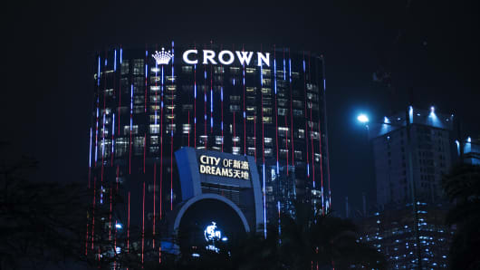 The City of Dreams complex, operated by Melco Crown Entertainment, stands illuminated at night in Macau in February 2016.