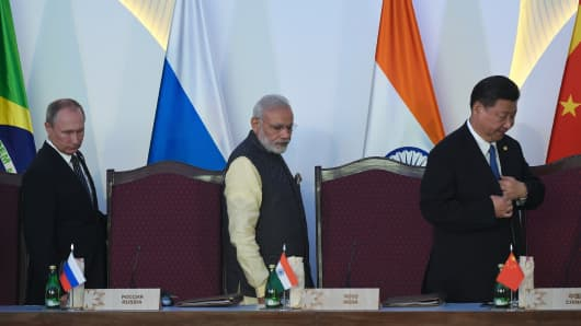 Russia's President Vladimir Putin,(L), China's President Xi Jingping (R) and India Prime Minister Narendra Modi arrive for the concluding session of the BRICS summit.