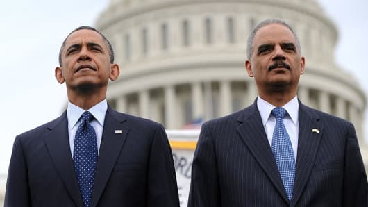 U.S. President Barack Obama and former Attorney General Eric Holder