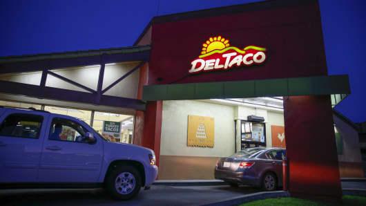 A customer orders at the drive-thru of a Del Taco restaurant in Gardena, California.