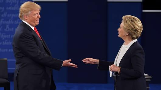 Democratic presidential candidate Hillary Clinton and U.S. Republican presidential candidate Donald Trump shake hands after the second presidential debate at Washington University in St. Louis, Missouri, on October 9, 2016.