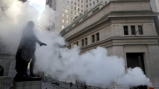The George Washington statue in front of Federal Hall on Wall Street is engulfed in a cloud of steam.