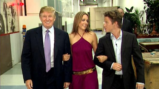 A 2005 frame from a video with Donald Trump (L), Arianne Zucker (C) and Billy Bush.