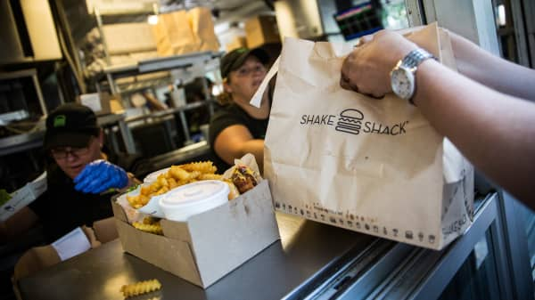 Customers pick up their orders from Shake Shack in Madison Square Park in New York.