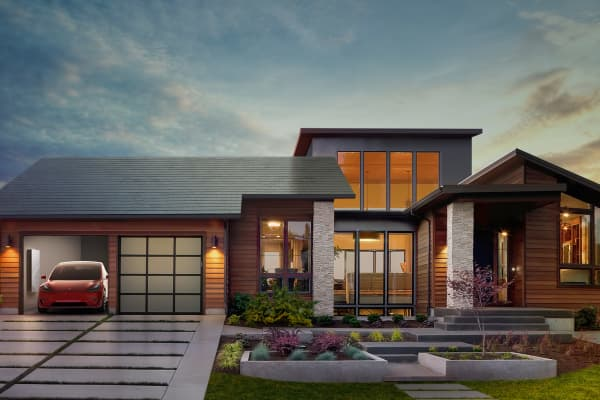 An image of Tesla's solar roof, new Powerwall 2 and Tesla charger.