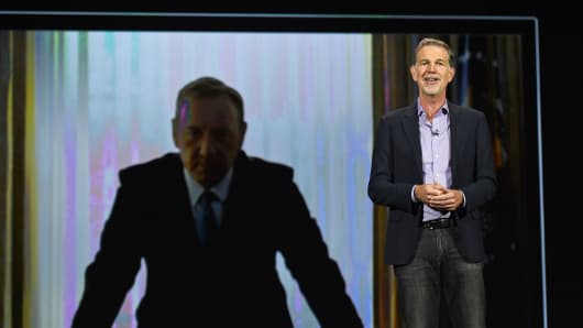 "Netflix CEO Reed Hastings delivers a keynote address in front of an image of actor Kevin Spacey from ""House of Cards"" during CES 2016 in Las Vegas."