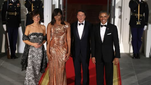 U.S. President Barack Obama and first lady Michelle Obama stand with Italian Prime Minister Matteo Renzi and his wife Mrs. Agnese Landini.