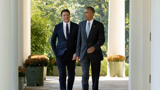 U.S. President Barack Obama and Italian Prime Minister Matteo Renzi walk down the Colonnade to hold a joint news conference.