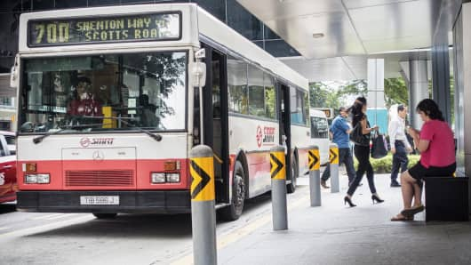 Passengers alight from an SMRT bus in the central business district in Singapore.