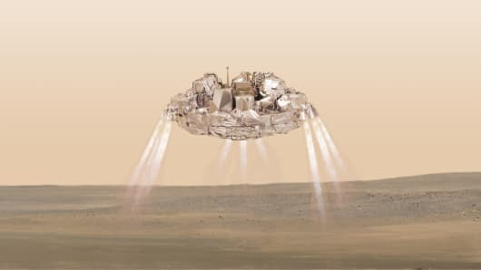 This artist impression provided by the European Space Agency, ESA, shows the Schiaparelli module with thrusters firing. On Wednesday Oct. 19, 2016 Schiaparelli will enter the martian atmosphere at an altitude of about 121 km and a speed of nearly 21 000 km/h. Less than six minutes later it will have landed on Mars.