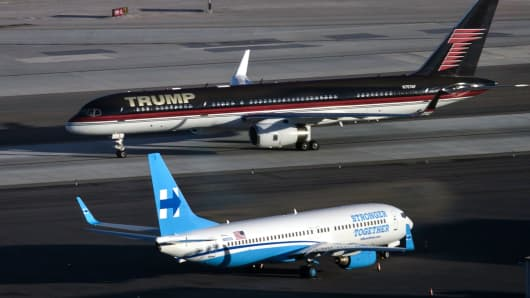 epublican presidential nominee Donald Trump's plane (TOP) passes Democratic presidential nominee Hillary Clinton's campaign plane at McCarran International Airport on October 18, 2016 in Las Vegas, Nevada, on the eve of the two candidates' third and final US presidential debate.