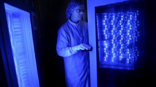 An employee tests blue light-emitting diodes (LEDs) at a Cree Inc. facility in Research Triangle Park in Durham, North Carolina.