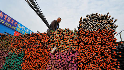 A labourer works at a steel market in the Hubei province of China.