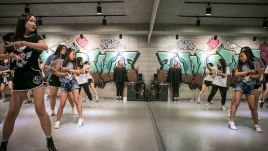 Young women practice moves at Def Dance School on August 10, 2016 in Seoul.  More and more South Korean children are spending hours training to make their dreams of becoming a K-Pop star true.