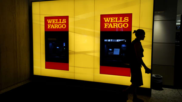 A customer leaves an ATM at a Wells Fargo branch in Denver.