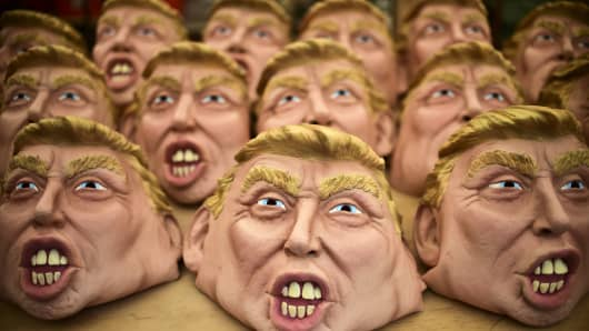 Masks representing US Republican presidential candidate Donald Trump are pictured in a factory of costumes and masks, on October 16, 2015, in Jiutepec, Morelos State.
