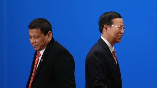 China's Vice-Premier Zhang Gaoli walks past Philippine President Rodrigo Duterte after he made a speech during the Philippines-China Trade and Investment Forum at the Great Hall of the People in Beijing on October 20, 2016.