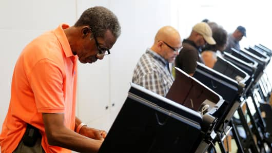 Voters cast their ballots during early voting in Charlotte, North Carolina, October 20, 2016.