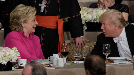 emocratic presidential nominee Hillary Clinton (L) and Republican presidential nominee Donald Trump shake hands after speaking during the Alfred E. Smith Memorial Foundation Dinner at Waldorf Astoria October 20, 2016 in New York, New York.