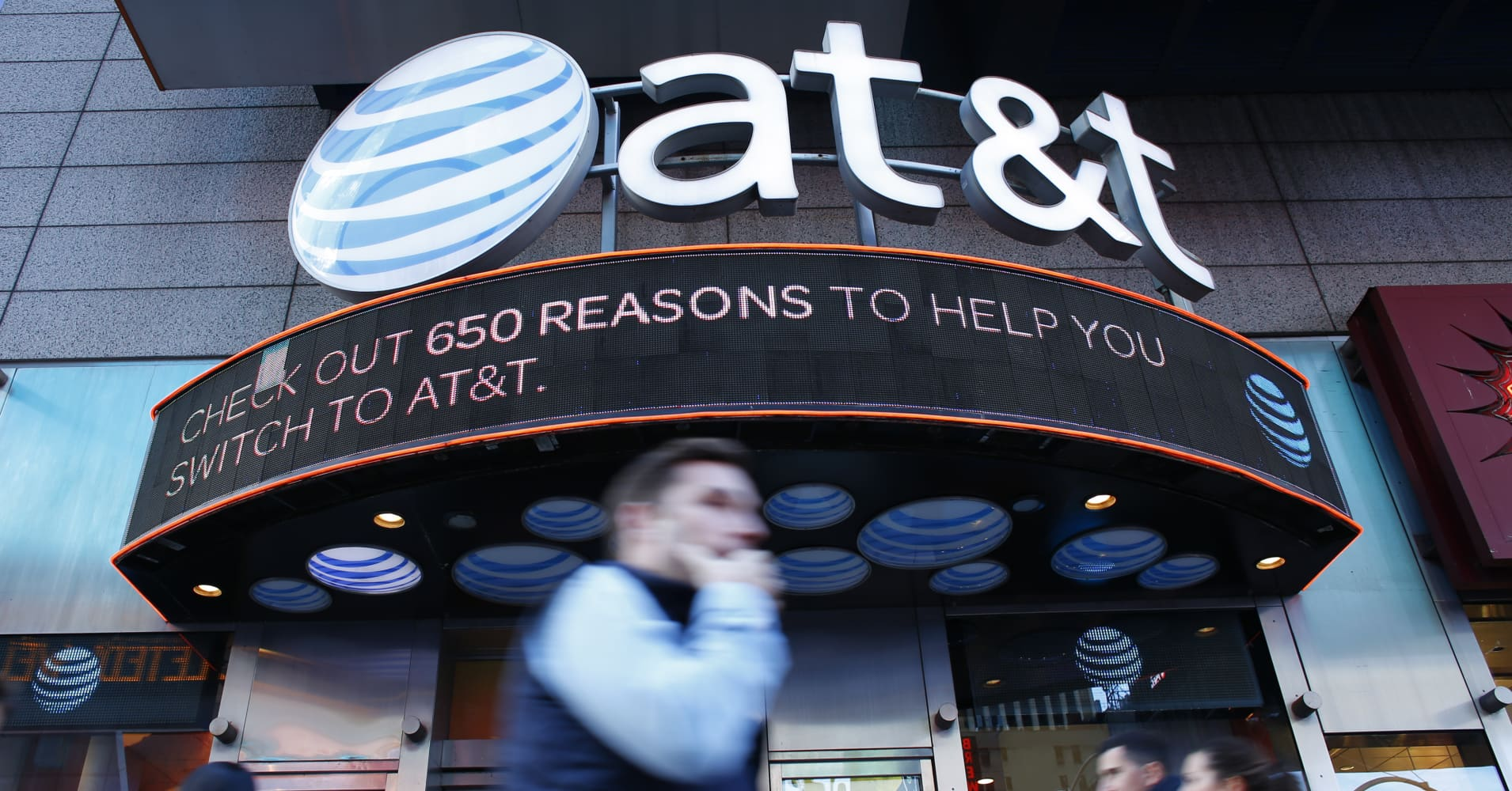 Att time warner merger brings new challenge for telecom stocks people walk past an att store in new york buycottarizona