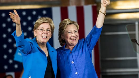 Former Secretary of State Hillary Clinton accompanied by Sen. Elizabeth Warren