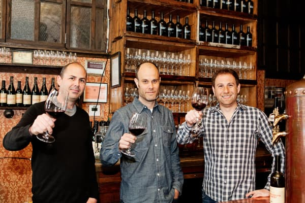 Brooklyn Winery co-founders John Stires and Brian Leventhal pose with winemaker Conor McCormack