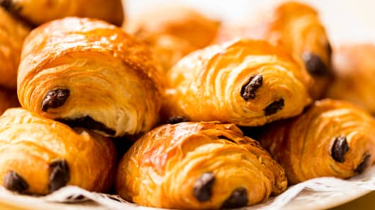 Pile of freshly baked croissants filled with chocolate