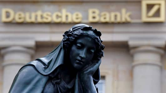 2016A statue is seen next to the logo of Germany's Deutsche Bank in Frankfurt, Germany.