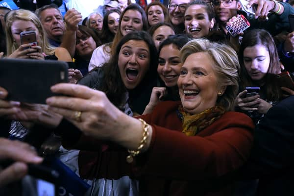 Democratic preisdential nominee former Secretary of State Hillary Clinton takes a selfie with supporters during a campaign rally at Allderdice High School on October 22, 2016 in Pittsburgh, Pennsylvania.