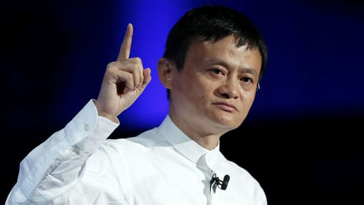 Jack Ma, chairman of Alibaba Group Holding Ltd., gestures as he speaks at SoftBank World 2014 in Tokyo, Japan.