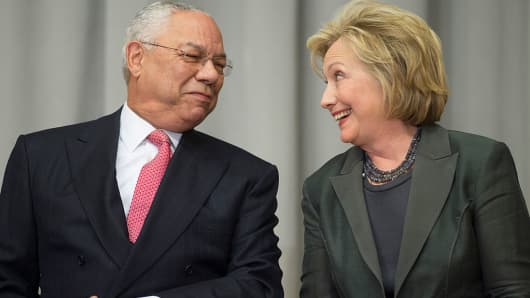 Former US Secretaries of State Colin Powell (L) and Hillary Clinton speak during a ceremony to break ground on the US Diplomacy Center at the US State Department in Washington, DC, September 3, 2014.