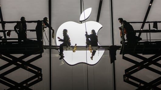 Workers prepare outside the largest Apple store in Asia for its opening on January 23, 2015, in Hangzhou, China.