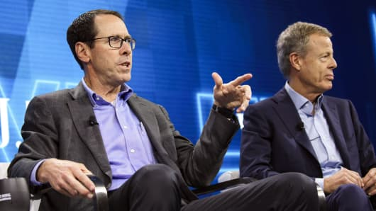Randall Stephenson, chairman and chief executive officer of AT&T, left, speaks while Jeffrey Bewkes, chairman and chief executive officer of Time Warner, listens during a conference in Laguna Beach, California, October 25, 2016.