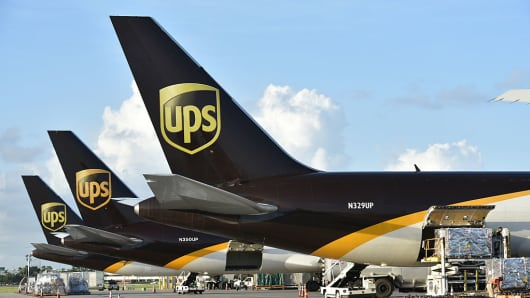 Workers unload United Parcel Service Inc. (UPS) cargo jets at the company's Latin America and Caribbean sorting facilities at Miami International Airport in Miami, Florida.