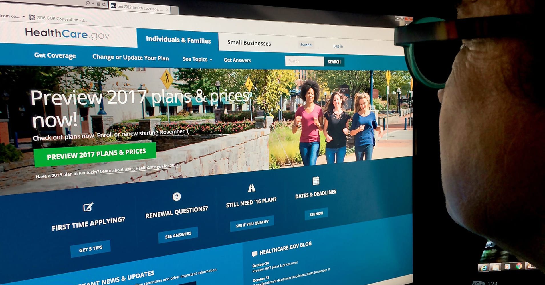 A woman looking at the Healthcare.gov internet site.