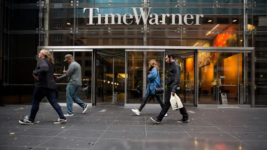 Pedestrians walk past the Time Warner Inc. Center in New York, U.S., on Saturday, Oct. 22, 2016.