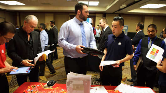 A Panda Restaurant Group representative, center right, speaks with a job seeker during an Orange County Choice Career Fair in Santa Ana, California, Oct. 6, 2016.