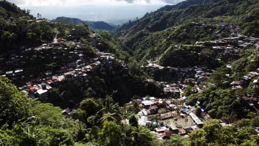 The mining settlement of Barangay on Mount Diwata (known as Diwalwal), in Compostela Valley, Mindanao. The mountain contains the largest gold deposit in the Philippines, and perhaps one of the largest in the world. The total area it covers is 8100 hectares, but the richest deposits lie in an area of just 729 hectares.