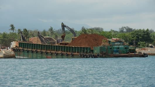 A barge being loaded with nickel ore at a private port in Pangasinan province, north of Manila.