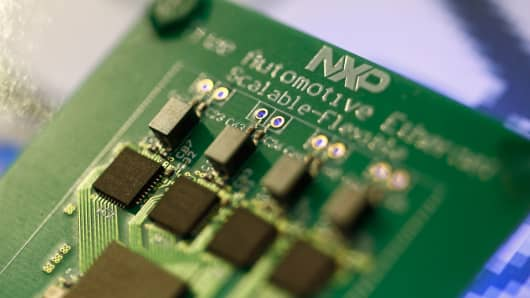 Microprocessors sit on a circuit board at the NXP Semiconductors NV pavilion at the Mobile World Congress in Barcelona, Spain.